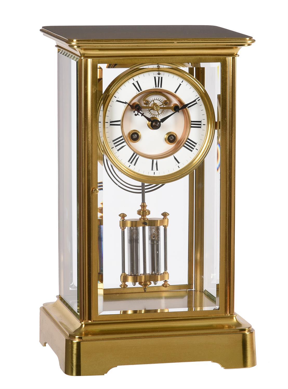 A French gilt brass four-glass mantel clock