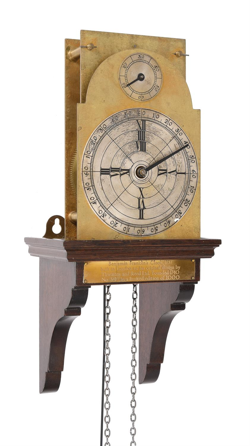 A weight-driven three-wheel 'Franklin' wall timepiece