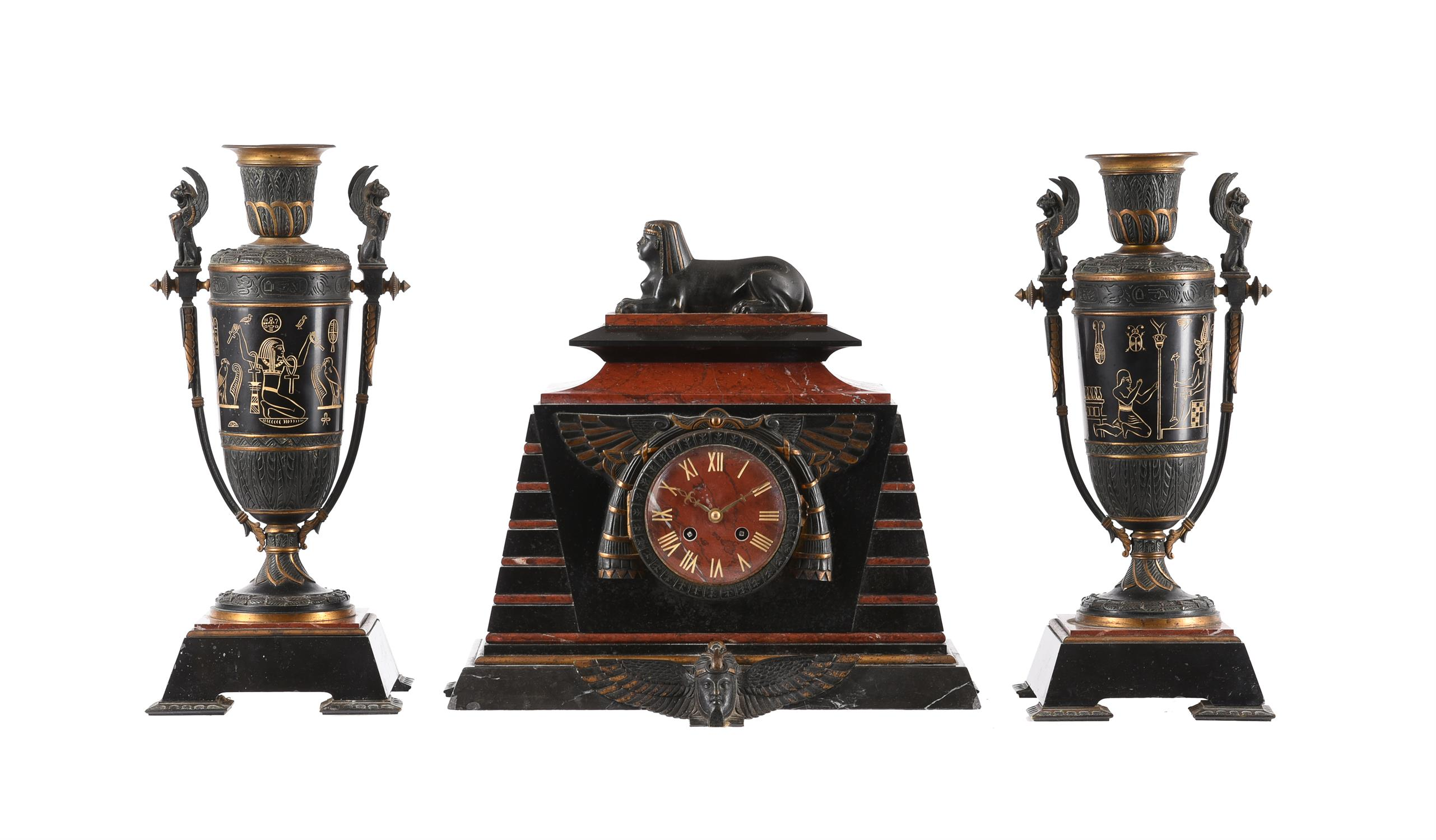A French Egyptian revival bronze mounted marble mantel clock garniture