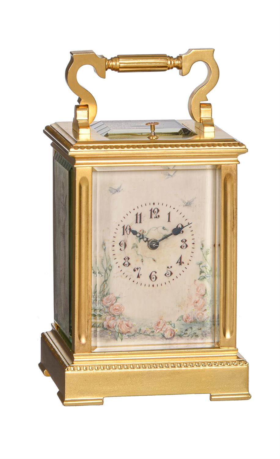 Y A French gilt brass carriage clock with painted ivory panels and push-button repeat
