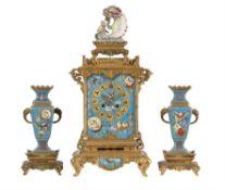 A fine French porcelain inset ormolu 'Japonaise' mantel clock garniture