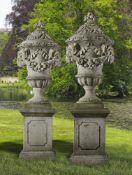 A pair of monumental Italian sculpted limestone urns in Neoclassical taste