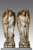 A pair of French sculpted and polychrome decorated terracotta figural torcheres modelled as angels