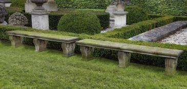 A pair of Continental limestone garden seats
