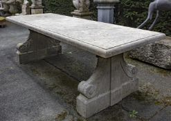 A carved limestone refectory garden table