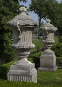 A pair of monumental carved limestone urns-and-covers