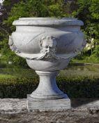 A sculpted Carrara marble garden urn
