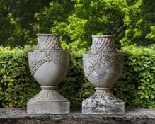A pair of French carved limestone urn finials