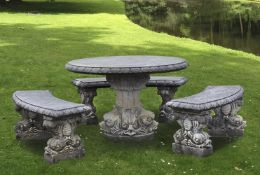 A suite of carved limestone garden furniture