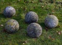 A group of five limestone ornamental spheres