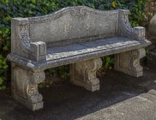 A carved limestone garden seat in 18th century style