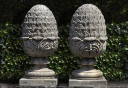 A pair of carved limestone pier finials