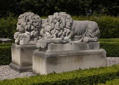 A pair of sculpted limestone models of recumbent lions