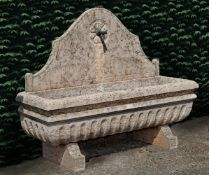 An Italian Rosso Verona marble wall fountain