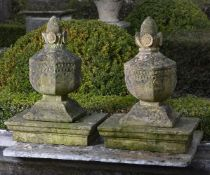A pair of French carved sandstone pier finials