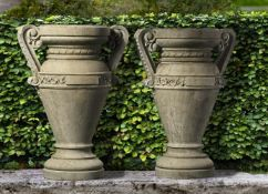 A pair of Italian carved Istrian stone urns
