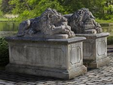 A pair of fine monumental sculpted limestone models of recumbent lions