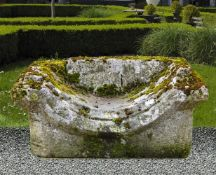A carved limestone garden bench