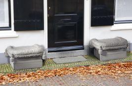 A pair of carved pierre du Bourgogne limestone garden seats