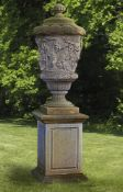 A sculpted limestone garden urn-and-cover