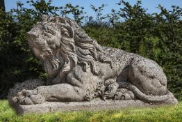 A sculpted limestone of a recumbent lion
