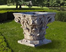 A massive Italian sculpted marble wellhead in the form of a Corinthian capital
