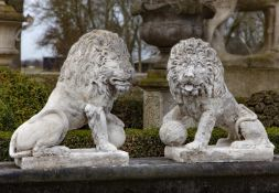 A pair of stone composition models of lions in 17th century style