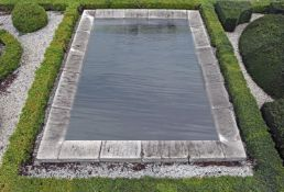 An ashlar cut Bourgogne stone rectangular pool surround