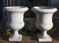 A pair of sculpted carrara marble campagna vases