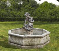 A Continental sculpted composition stone figural garden fountain
