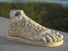 A sculpted marble model of a foot