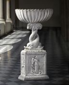 A Continental sculpted white marble basin on plinth