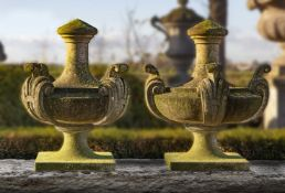 A pair of large Continental carved limestone urn finials