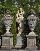A pair of monumental carved limestone urns-and-covers, in Louis XVI taste