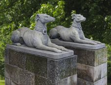 A pair of sculpted limestone models of recumbent hounds