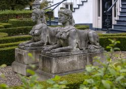 A pair of substantial sculpted limestone models of recumbent female sphinges