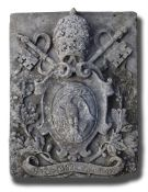 A sculpted limestone armorial panel