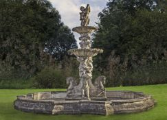 An elaborate and impressive stone composition two-tier garden fountain
