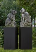A pair of French sculpted limestone models of watchdogs
