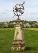 A wrought and cast iron mounted carved limestone armillary sphere