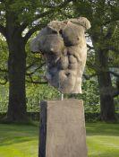 A sculpted limestone model of a male torso