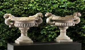 A pair of Continental sculpted white marble garden urns in Neoclassical style