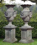 A pair of impressive carved limestone urns
