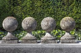 A set of four carved limestone pier finials