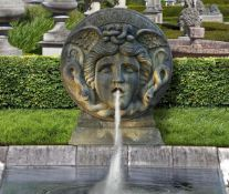 A Continental, probably Italian sculpted limestone wall fountain