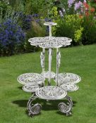 A white painted cast iron conservatory jardinière stand