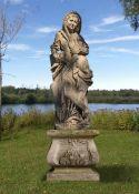 A sculpted limestone garden figure emblematic of winter