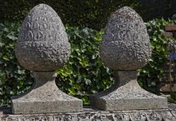 A pair of sculpted limestone pier finials modelled as stylised acorns