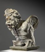 A Continental sculpted limestone fountainhead carved as the stylised head of a bearded man