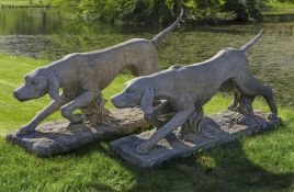 A pair of carved limestone models of hounds